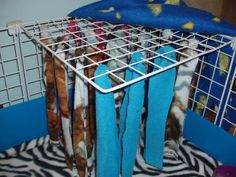fleece strips tied to top of cage- I think I need to make this for Lilly because she always runs and hides behind things when the lights turn on. She would love this!