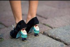 Seriously! That's crazy but pretty funny. I probably wouldn't stop laughing if I was walking down the street and saw a woman in a business suit and heels and then noticed that the heels were gnomes. Haha!! Gnome heels! by dorothea