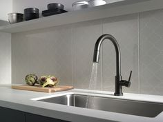 6 Reasons to Love a Matte Black Faucet: To Emphasize a Patterned Wall's Curvy Print | Delta Faucet Inspired Living