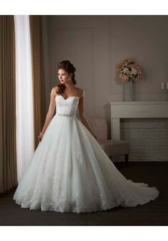 I like this one.  It seems very elegant.  The bodice is nice, I like the belt and the skirt has a perfect amount of detail.   Bonny Bridal-414