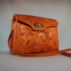 Beautiful flower-tooled leather purse.