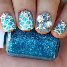 """@riot_pr is beach ready! lol love this mani!!!!from @riot_pr Mermaid nails Base is @ultabeauty """"Snow White"""", glitter gradient is composed of """"Aquamarine Dream"""" & """"Real Teal"""", both from @simplybeautiful1973 & """"Absinthe"""" from @inthenameofpolish Mermaid scale vinyls are from the shop of @lou_it_yourself The starfish & pearl studs are from #bornprettystore, item numbers 20116 & 20117 You can use code RIOTK31 to save 10% on your order from @bornprettystore"""