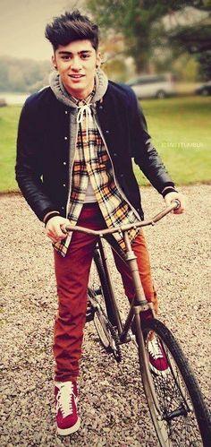 zayn...on a bike... kinda weird but it's hot haha