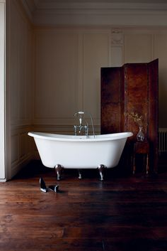 Free standing stone bath in traditional panelled bathroom