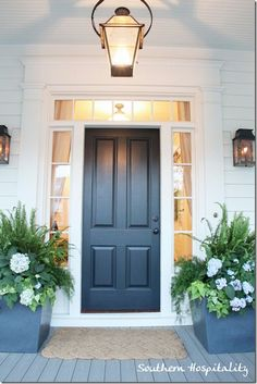 Love these dark grey planters with ferns, hydrangeas and sweet potatoe vine. Elegant front door look Front Door Planters, Front Door Porch, Grey Front Doors, Solid Doors, Front Door Colors, Black Doors, House Front, Front Entry, Portico Entry