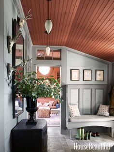 """This """"boot room"""" pairs warm red ceilings with gray, pine walls. Designer: Charles O. Schwarz III Make the seat with panelling Cottage Design, House Design, Two Tone Walls, Pine Walls, Charming House, Decoration, Beautiful Homes, House Beautiful, Beautiful Images"""