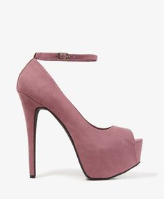 A pair of faux suede platform heels featuring a peep-toe and a buckled ankle strap. Padded insole. Textured outsole.    DETAILS: