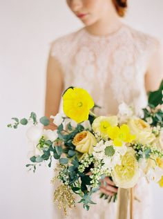 Organic-looking bouquet brightened by yellow poppies