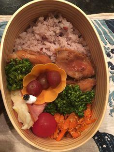 Teriyaki Chicken bento Teriyaki chiken, fried carrot with miso and sesame, potato salad wrapped with ham, broccolini, cherry tomato, grapes, 6grain rice