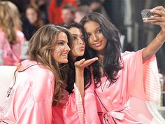 Cameron Russell, Shanina Shaik, and Jasmine Tookes in their signature pink Victoria's Secret robes.