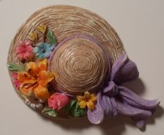 Straw hat with flowers lapel pin.