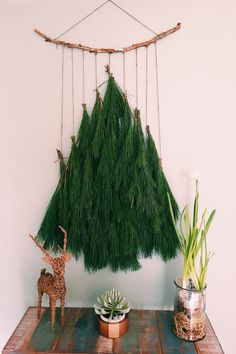This was a favorite wall hanging I made from left over pine garland. It was one of my favorites last year and I can't wait to make one again! | holiday decor | boho decor | wall hanging | Christmas decor |