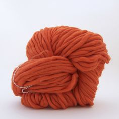 I absolutely ADORE this yarn. It is fat, chunky, and gorgeous. I want to make a pouf with it! Too bad it costs $90 a skein...