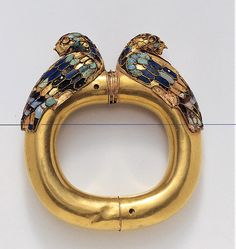 Achaemenid Gold Bracelet with Inlaid Termini in the Form of Seated Ducks      Gold with lapis lazuli,  turquoise, onyx, and rock  crystal inlay, mid-6th-4th  century B.C.E.