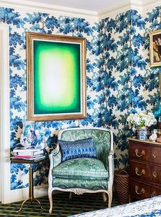 Inside the stunning home of the Ultimate A-list decorator: Alex Papachristidis. Green Shadow by Anish Kapoor hangs over the chair upholstered in Fortuny fabric, used on the reverse for a more antique look. The Swedish wallpaper from Old World Weavers was inspired by the Château de Groussay. Photo by Lesley Unruh. One Kings Lane Designer Houses.