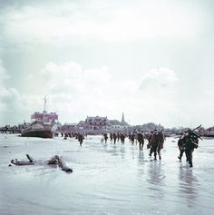 Troops of the 3rd Canadian Infantry Division land at JUNO Beach on the outskirts of Bernieres-sur-Mer on D-Day 6th June, 1944.
