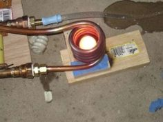 12KW Induction Heater - Homemade 12KW induction heater utilizing a workcoil fashioned from ?