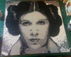 Princess Leia For the females of Star Wars art show @destinycitycomics Dec. 10th  Roughly 12,300 beads Roughly 2ft x2ft  Still needs a name.  #perlerbeads #perler #8bit #pixels #pixelart #starwars #rave #kandi #handmade #edm #crafts4nerds #diy #crafts #pr