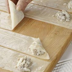 This succulent take on the classic Greek snack gets its rich flavor from feta cheese and spinach. Phyllo dough dries very quickly so keep sheets covered until needed.