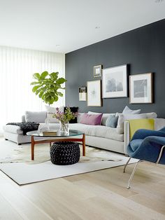 Dark modern living room design with statement black wall | M House, Inc