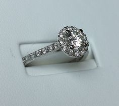 Spirit Of Flanders Raised Table Diamond Halo Engagement Ring  http://www.BloomingBeautyRing.com