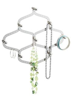 This wall-mounted hook expands and contracts -- perfect for organizing all your jewelry. #GetOrganized