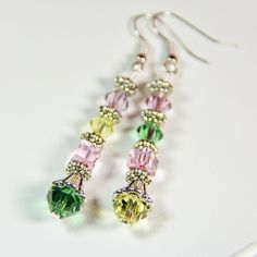 Adorn yourself in brightly faceted pastel colors. Or gift them to your favorite sunny soul. These sparkling Swarovski crystal and silver drop earrings are in a class by themselves. The pair drops 2 inches from surgical steel ear wires. Each earring features four Swarovski crystals in light pink, green and yellow. Bicones are 4mm and 8mm. Pink cubes are 6mm. Four silver finish spacers and a silver-plated pewter cone complete each earring. Buy now. $20 at #SmallestPlanet via Shopify.
