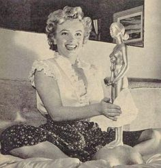 Marilyn shows off her Henrietta Award the day after the awards in her suite at the Beverly Carlton Hotel. January 28th 1952