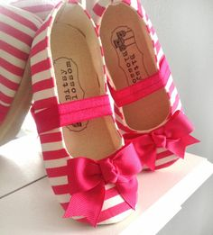 This adorable toddler girl shoe is just right for those fun loving outfits! Made with a cheery hot pink and white striped fabric and embellished at the toe with a sweet coordinating bow.Bitsy Blossom's baby shoes are all handmade and created with great care and attention to detail. All of our shoes are made with modern and unique textiles. The insole is lightly padded for extra comfort. The soling material is waterproof, durable, abrasion resistant, slip resistant, and resistant...
