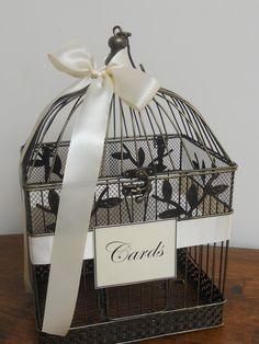 I don't like the baskets.  Too picniceeee. I do like the bird cage idea though.