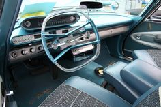 1960 Plymouth Fury interior Note the squared steering wheel and swiveling seats.