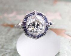 1.55 ct OEC in Brand New CVB/LAD sapphire halo : Natural Diamond Center