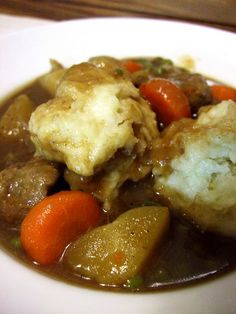 beef stew and dumplings (made the same way I make stew. secret ingredient BEER, topped off with fluffy dumplings..Mmmm mom would be proud :)