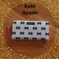 "NWT Kate Spade BOWS Neda Wallet Super Cute!!!  Kate Spade BOWS wallet in Black, Cream and Bright Pink. Kate Spade logo on front, and slip pocket across the back for even extra storage. Zip around closure. Interior had 12 ID slots, middle zip compartment for coins and 2 full length bill compartments. Measures 8""x4.5""x1. kate spade Bags Wallets"