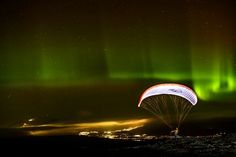 Night take off in full aurora Photo by Mats Lind -- National Geographic Your Shot
