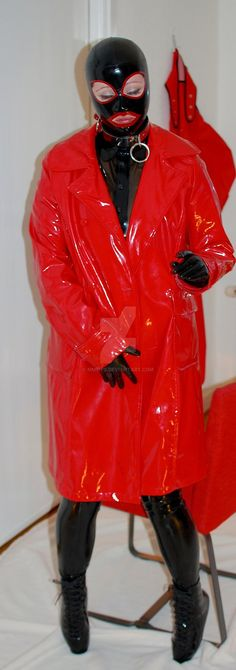 Look how she can't keep her hands off her vagina area. She's definitely rubbing herself with those latex rubber gloves against that PVC vinyl coat with the rubber suit underneath. I'd be so horny as well if I were wearing what she has on.