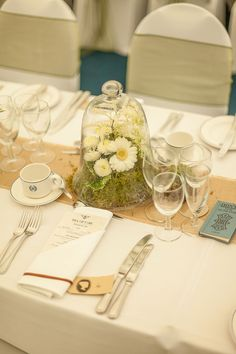 Bell-jar and flowers for this table centrepiece.  http://www.isleofwightweddingphotographer.co.uk/