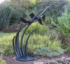 garden sculpture of birds in flight