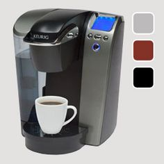 I really don't have a problem with our current coffee maker, I'm just very intrigued by these single serving makers... maybe perfect for the office? Hmmm...