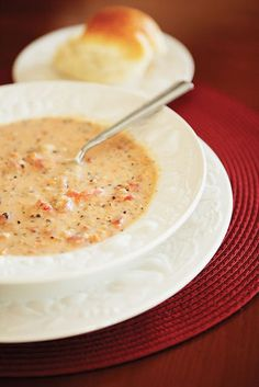 "Slow Cooker Tomato Basil Parmesan Soup ***Omigosh. This soup is...in a word...divine. My husband took a few bites and said, ""Wow...this is restaurant soup!"" It's smooth and creamy goodness. Definitely puree the onions, carrots, celery and tomatoes in the food processor so it's not too chunky. So yummy. This is one of the best things I've ever made. Love it!"