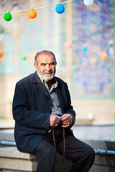Muslim man with prayer beads in Iranian Mosque by damonlynch, via Flickr