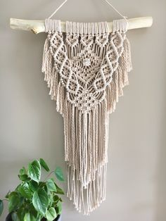 Made with beige 4mm cotton rope. Measuring 56cm wide (branch width) x 86cm long (measured from branch down). Postage charge at checkout will be $10. Your piece will be wrapped