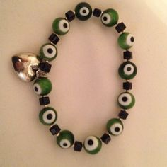 "Bracelet Good luck Italian glass  ""eye"" stretch bracelet. Green, white, black glass bead, faceted jet crystal, silver plate heart charm.  #2011B Jewelry Bracelets"