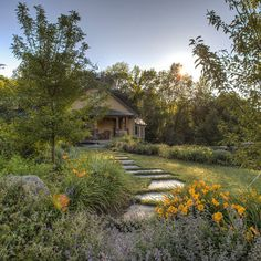 A large scaled stone path through the garden and lawn. More images of the project on Houzz by JMMDS.