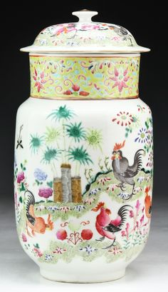 """A Chinese Antique Famille Rose Porcelain Lidded Vase: with the scene of roosters surrounding the body and lid, signed 'YONGZHENG' on the base Size: H: 10-3/4"""""""