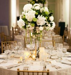 Want to make a statement with your #centerpieces? Add some height. Love these tall arrangements of hydrangea, roses, and amaranth: http://shout.lt/pksM