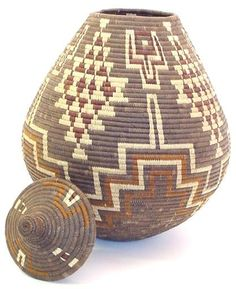Zulu basket |  Made from coil grass and Ilala palm leaves and natural dyes. The geometric pattern has special significance in the Zulu culture.