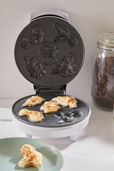 A waffle maker sure to make your whole herd jealous whenever you do brunch at your place. 37 Gifts To Give Your Dinosaur-Obsessed Friend Before They Go Extinct Urban Outfitters, Pancake Maker, Donut Maker, Snack Bowls, Waffle Iron, Dinnerware Sets, Strip Lighting, T Rex, Kitchen Accessories