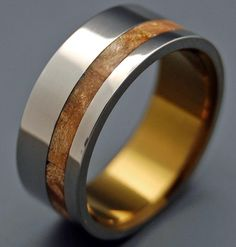 Mythical and magic. Silver Faun pairs shining titanium with glowing bronze for a gentle, inspiring ring. The mirror-finished titanium band holds a narrow, offset inlay of warm Spalted Maple. Pictured