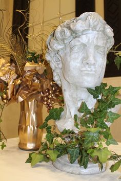 Gala of the Gods Greek Prom 2015 statue at entrance table, golden grapes and peacock feathers